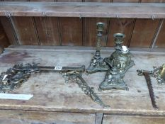 A PAIR OF VICTORIAN MASK DECORATED CANDLE STICKS AND MATCHING INKWELL, TOGETHER WITH FOUR BRASS