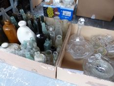 A COLLECTION OF VINTAGE BOTTLES, HOT WATER BOTTLES, AND MISC. GLASSWARES.