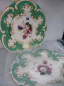 A PAIR OF ROCKINGHAM WORKS HAND PAINTED FLORAL CABINET PLATES.