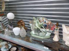 AN ART DECO MIRROR BACKED FIGURINE OF A NUDE, A CHROME TERRIER TABLE LAMP, GLASS LIGHT SHADES A