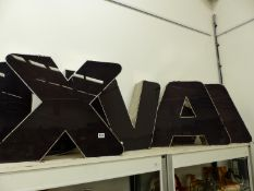 A GROUP OF FIVE LARGE ADVERTISING LETTERS, LETTERS ARE X,U V,A,A.