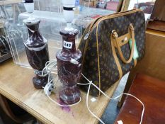A MARBLE TABLE LAMP AND OVERNIGHT BAG.