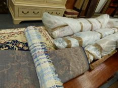 VARIOUS ROLLS AND PART ROLLS OF UPHOLSTERY FABRICS AND TWO SMALL RUGS.