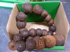 A ROW OF 25 AFRICAN CLAY DECORATED BEADS. LARGEST DIAMETER APPROX 3cms.