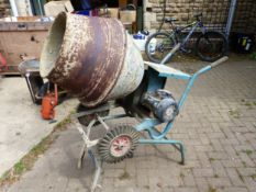 AN ELECTRIC CONCRETE MIXER COMPLETE WITH TRANSFORMER AND ANGLE CUTTER