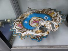 A SEVRES STYLE COMPORT PAINTED WITH FLOWERS ON A TURQUOISE GROUND