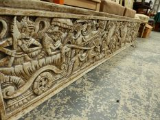 A BURMESE CREAM PAINTED PANEL CARVED WITH FIGURES AND CHARIOTEERS