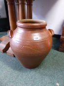 A BROWN SALTGLAZE TWO HANDLED JAR, POSSIBLY WINCHCOMBE