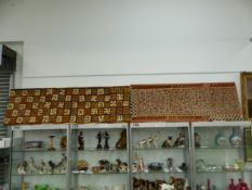 AN AFRICAN APPLIQUE TEXTILE PANEL TOGETHER WITH ANOTHER GEOMETRICALLY WOVEN