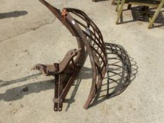 TWO CAST IRON HAY MANGERS AND LARGE PLOUGH ATTACHMENTS