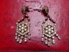 A PAIR OF SILVER AND ROSE GOLD PLATED VICTORIAN STYLE ARTICULATING CHANDELIER DROP EARRINGS. DROP