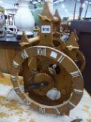 A WOODEN MECHANICAL CLOCK