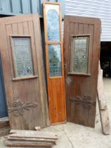 A PAIR OF PITCH PINE DOORS WITH CENTRE PANEL AND FRAME, ALL WITH LEADED GLASS WINDOWS ( FOR