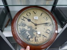 A MAHOGANY FRAMED WALL TIMEPIECE INSCRIBED HOVIS BREAD SOLD HERE