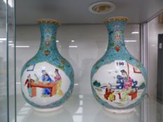 A PAIR OF CHINESE TURQUOISE GROUND BOTTLE VASES