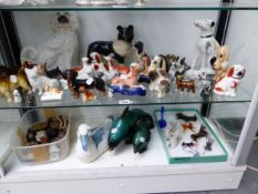 A COLLECTION OF CERAMIC DOGS AND OTHER FIGURES