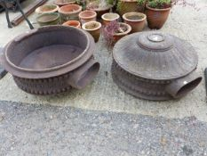 A PAIR OF UNUSUAL ANTIQUE CAST IRON VENTILATION CYLINDERS