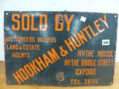 A VINTAGE HOOKHAM & HUNTLEY ENAMELLED SIGN.