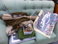 A CAMP BED, MILITARY CLOTHING, FRAMED PRINTS OF LOCOMOTIVES, TROPHIES, A NORMAN ROCKWELL AND A