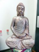 A SILVERED FIGURE OF THE BUDDHA SERENELY SEATED