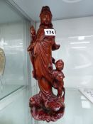 A CHINESE CARVED WOOD FIGURE OF GUANYIN WITH CHILD ATTENDANT
