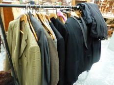 A QUANTITY OF VINTAGE GENTLEMANS SUITS AND JACKETS INC. BURBERRY, HECTOR POWE, RAIL NOT INCLUDED.