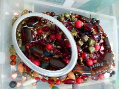 A COLLECTION OF COSTUME JEWELLERY TO INCLUDE BEADS, BROOCHES, RINGS, SHELLS ETC.
