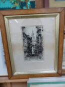 AN EARLY 20th CENTURY ETCHING OF A STREET IN TOLEDO, INDISTINCT PENCIL SIGNATURE, 42 x 24cm,