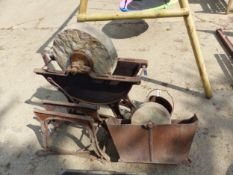 TWO CAST IRON MILL STONES AND A COOKING POT