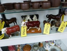 A COLLECTION OF FOUR BESWICK COWS AND THREE HORSES