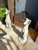 A PAIR OF COMPOSITE STONE DOGS
