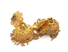 A PAIR OF EASTERN FILIGREE ARTICULATED CHANDELIER EARRINGS FITTED WITH SCREW BACKS. UNMARKED AND
