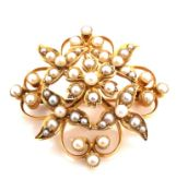 AN ANTIQUE 15ct STAMPED SEED PEARL FOLIATE BROOCH / PENDANT. MEASUREMENTS 3.3 x 3.2grms. WEIGHT 7.