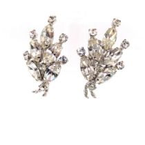 """A PAIR OF VINTAGE """"MAKE WOMEN FEEL SPECIAL"""" RHINESTONE CLIP ON EARRINGS BY SHERMAN, SIGNED TO CLIP"""