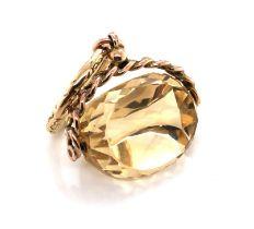 AN EDWARDIAN CITRINE QUARTZ FANCY CUT SPINNING FOB. THE GOLD SUSPENSION HALLMARKED 9ct, BIRMINGHAM