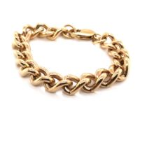 A 9ct SOLID GOLD HALLMARKED LADIES HEAVY CURB BRACELET, DATED 1984 LONDON.LENGTH 19cms. WEIGHT 47.