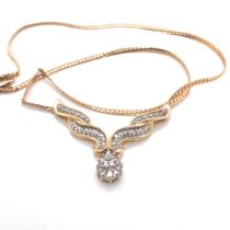 A BAGUETTE AND BRILLIANT CUT DIAMOND PENDANT WITH AN ARTICULATED DROPPED SUSPENDED ON A FLAT LINK
