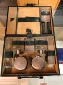 A SUEDE LINED GREEN LEATHER DRESSING CASE WITH 800 SILVER FITTINGS ENGINE TURNED ABOUT THE