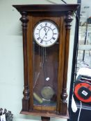 A VIENNA REGULATOR IN A GLAZED STAINED WOOD CASE, THE ENAMELLED DIAL WITH SUBSIDIARY SECONDS, THE