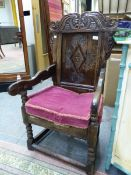 A LATE 17th/EARLY 18th C. OAK WAINSCOT CHAIR, THE BACK PANEL CARVED WITH THREE ROUNDELS TO EACH OF