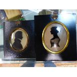 TWO OVAL SILHOUETTES ON GLASS, ONE LABELLED VERSO MRS THOS HYAM, THE OTHER MR C. DAWSON