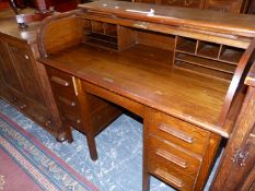 A VINTAGE OAK SLATTED ROLL TOP DESK WITH THREE DRAWERS TO EACH PEDESTAL. W 115 x D 67 x H 101cms.