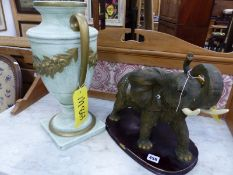 A LARGE ELEPHANT ORNAMENT AND A TABLE LAMP BASE.