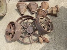 FIVE CAST IRON RAIN HOPPERS, A PAIR OF CAST IRON FINIALS, TWO PAIR OF CART WHEELS