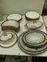 A SPODE COPELANDS CHINA PART BLUE AND WHITE DINNER SERVICE, THE SIDE PLATES WITH ARMORIAL CREST.