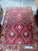 A PERSIAN TRIBAL RUG, 227 x 145cm. TOGETHER WITH A CONTINENTAL PILED RUG 160 x 95cm AND A PERSIAN