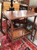 A MAHOGANY TABLE, THE GALLERIED LOWER TIER JOINING RING TURNED CYLINDRICAL LEGS. W 57 x D 41 x H