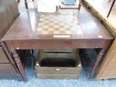 A MAHOGANY FLAP TOP GAMES TABLE, THE CENTRAL CHESS BOARD SLIDING OUT TO REVEAL A RECESSED BACKGAMMON