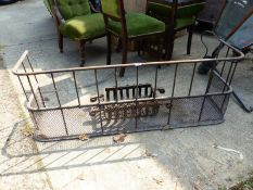 A SMALL CAST IRON FIRE GRATE AND A FENDOR