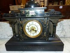 A GREEN MARBLE INSET BLACK SLATE CASED STRIKING CLOCK, THE DIAL WITH ARABIC NUMERALS BELOW A CUPOLA